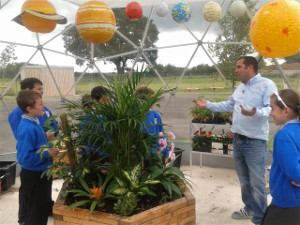 BBC Gardener Chris Collins inside dome with pupils