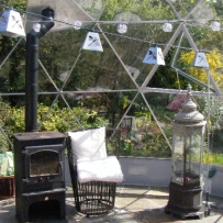 SOLARDOME Haven, casual seating and wood burning stove