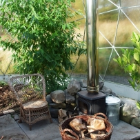 Outdoor room with wood burning stove