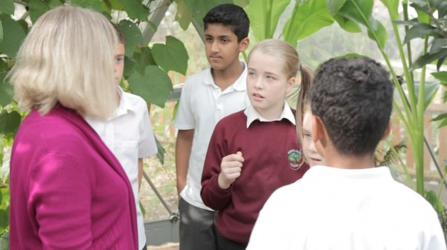 Children learning outside the classroom with teacher